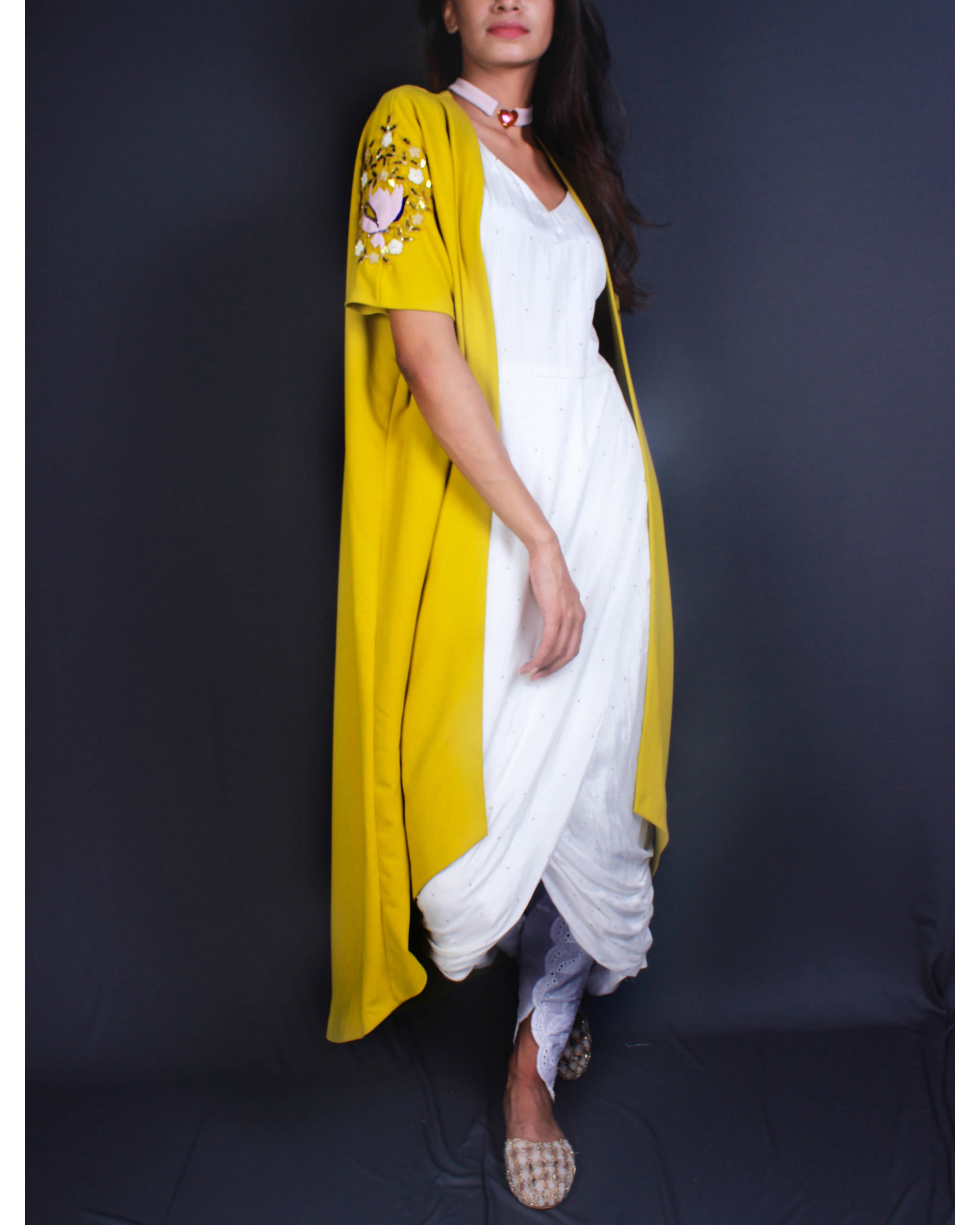 White draped kurta and dhoti pants and lime cape