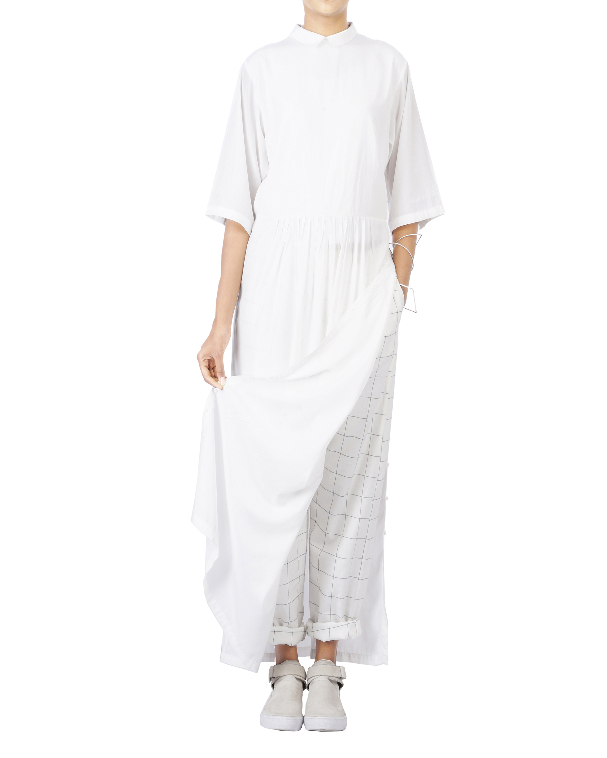 White dropped waist dress with side button opening