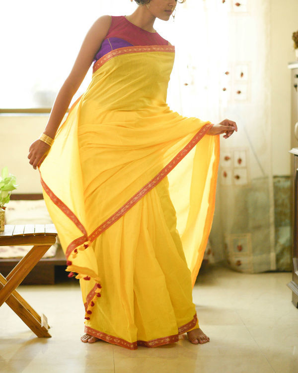 Sunrise yellow sari with paisley border