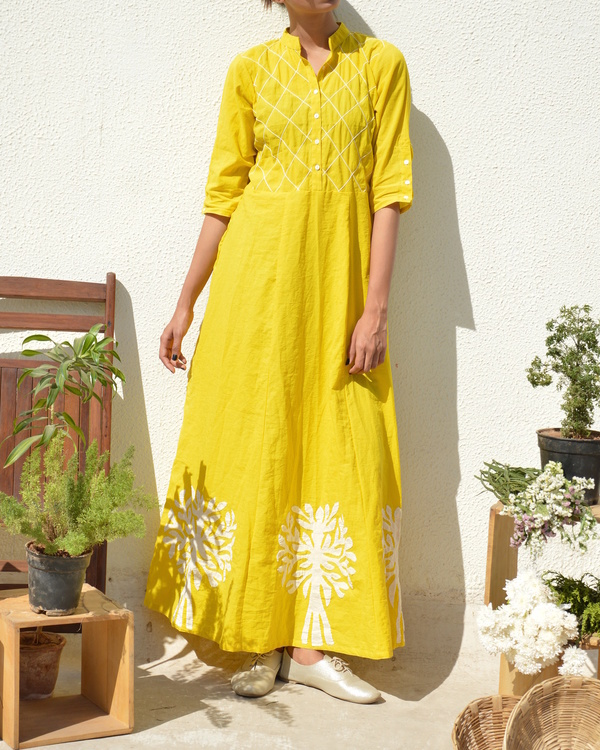 Yellow applique and tucks dress