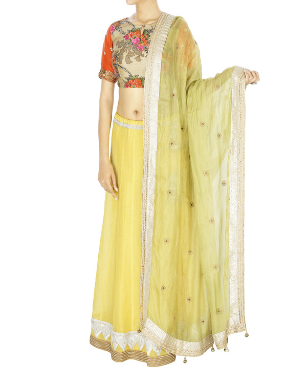 Yellow chanderi lehenga with green silk kota dupatta and floral blouse