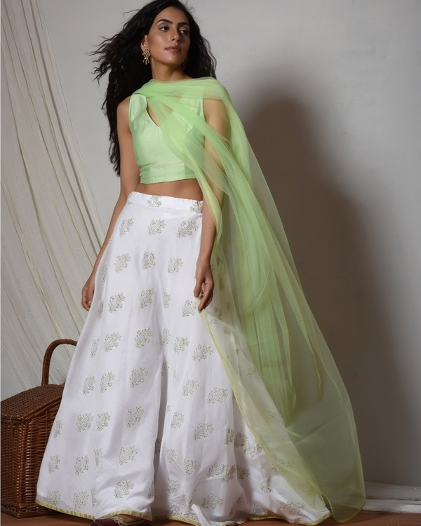 Floral print mint green chanderi lehenga set with net bordered dupatta
