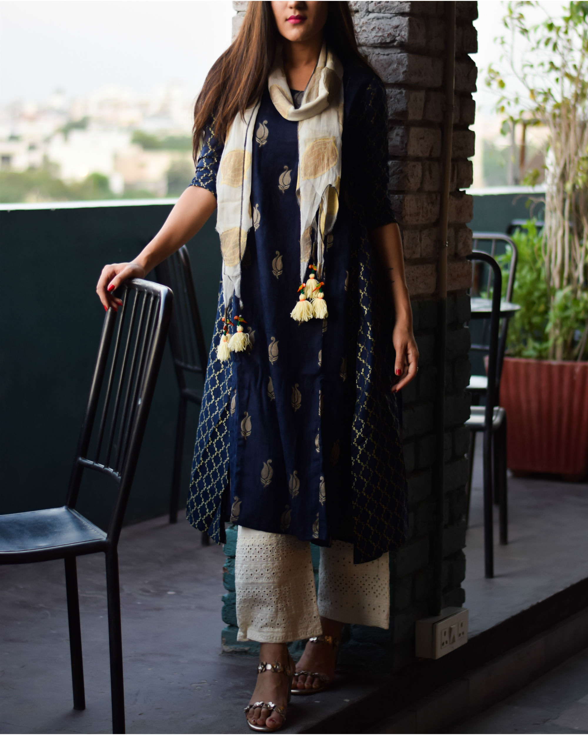 Deep blue anarkali with cutwork pants and tasseled stole
