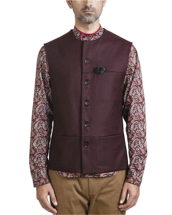 Maroon woollen asymmetric sleeveless jacket