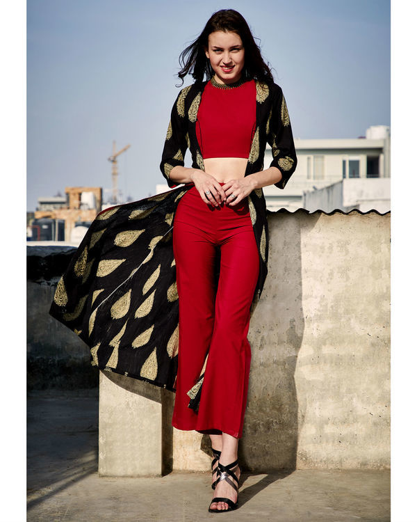 Red crop top and pants with black cape