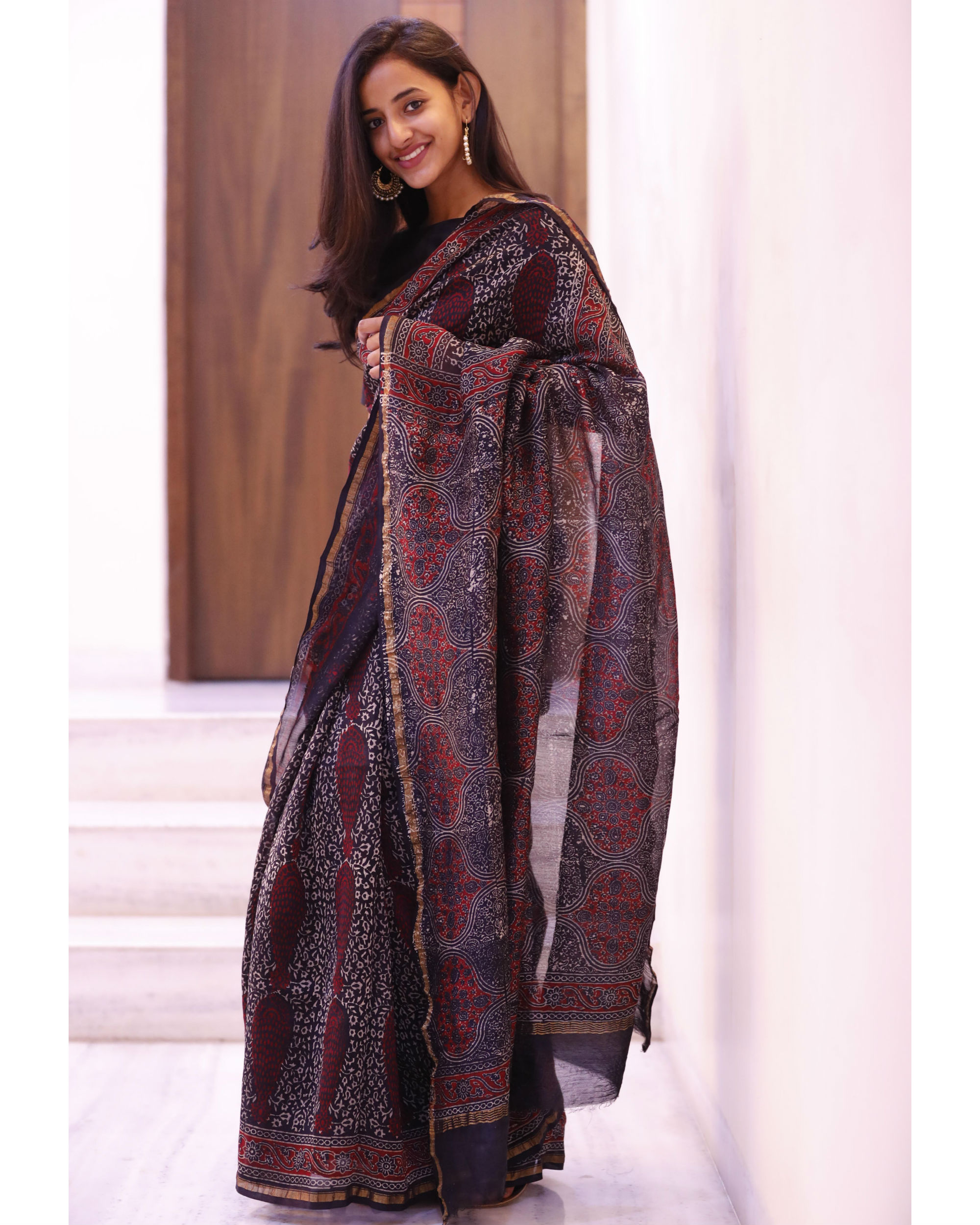 Black and maroon motif sari