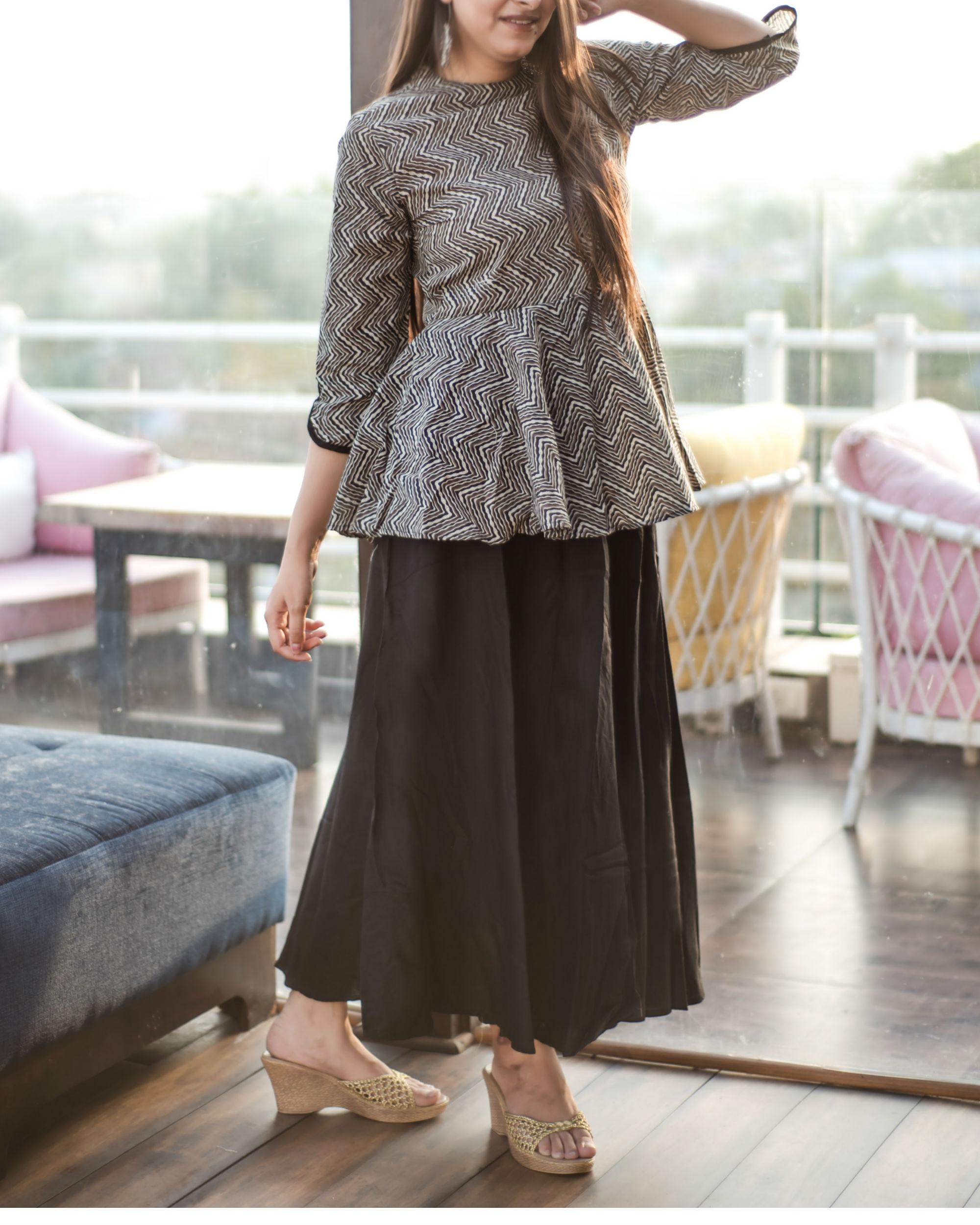 75f3c3457f453 Black and off-white peplum dress by Label Harsha Khatry