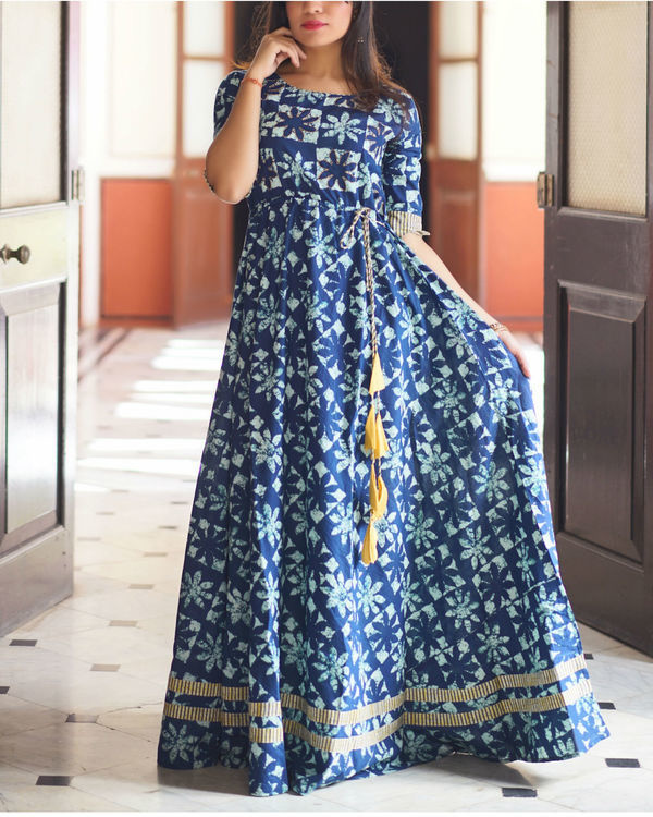 Indigo gown with fabric tassels
