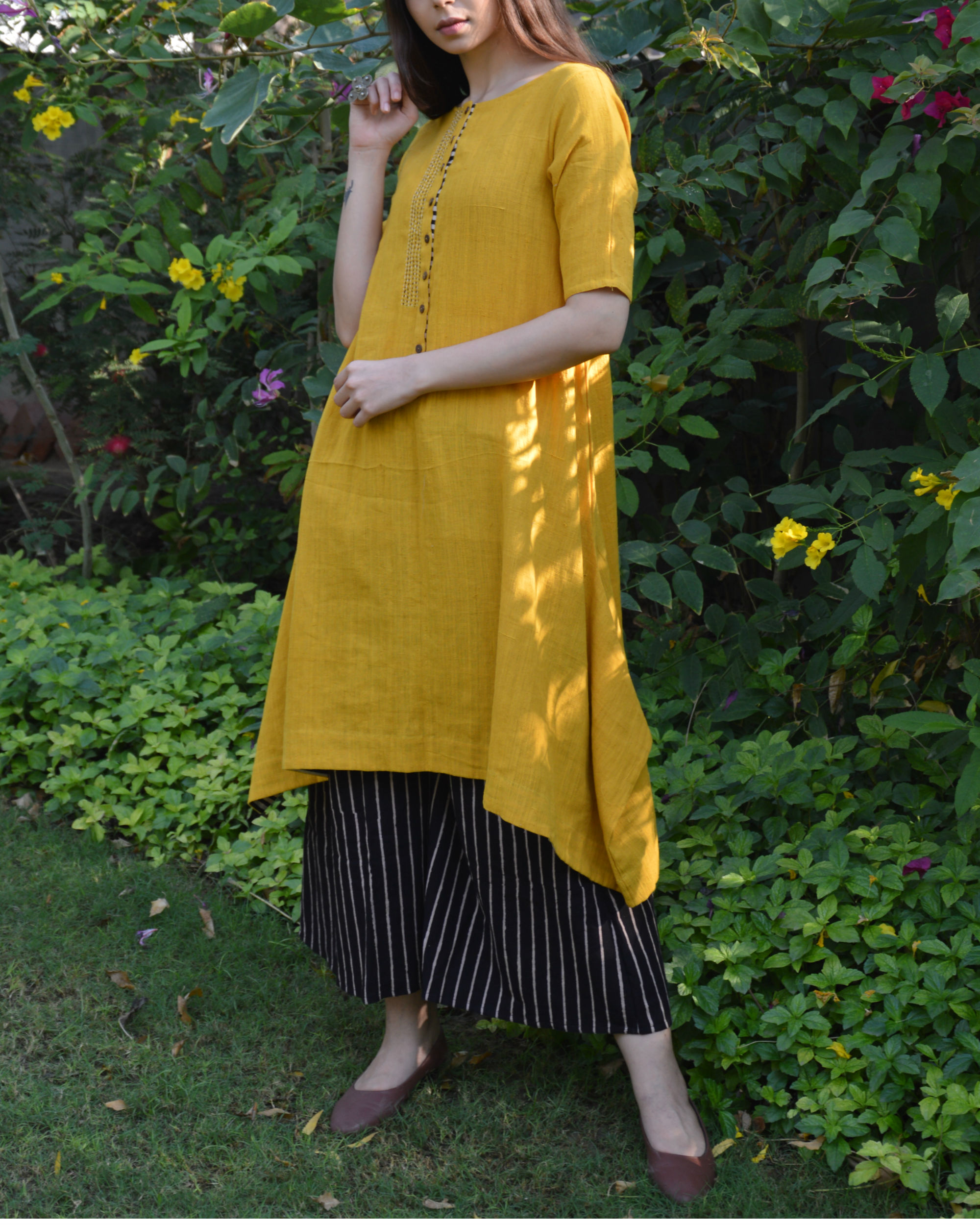 Mustard c-hem tunic with black striped palazzo