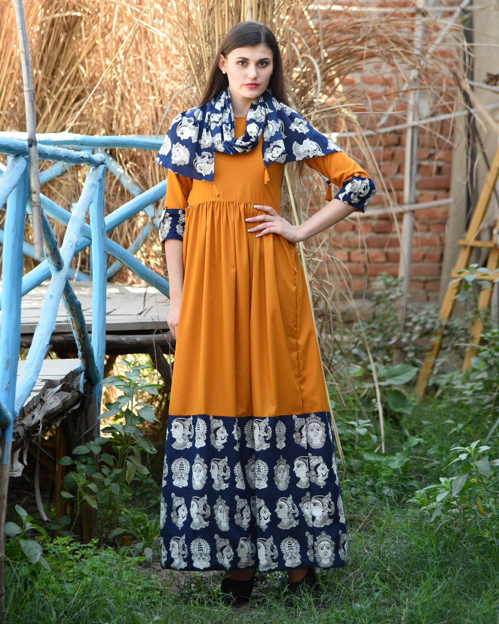 Orange rust gathered dress with kalamkari border