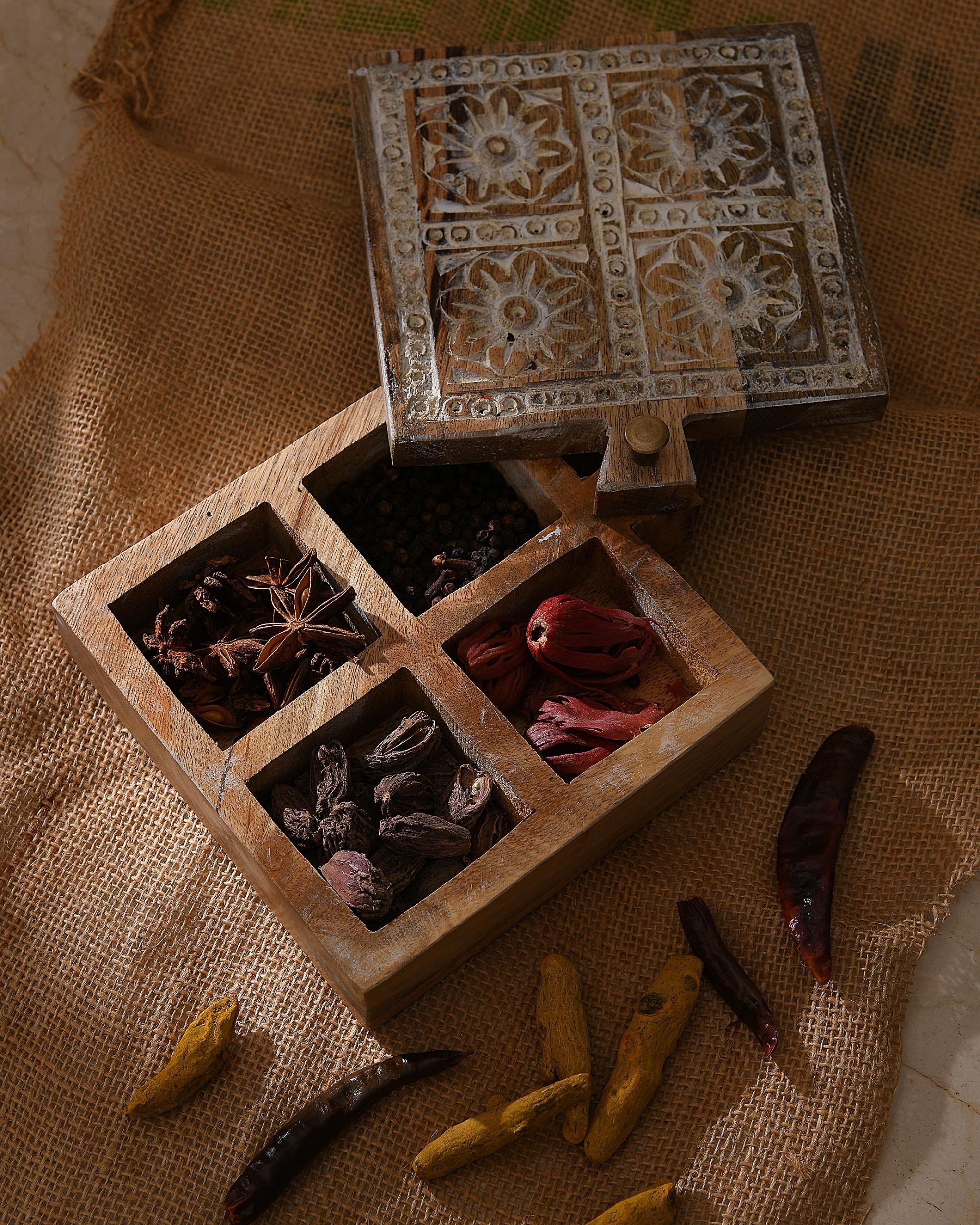 Square shaped carved wooden spice box
