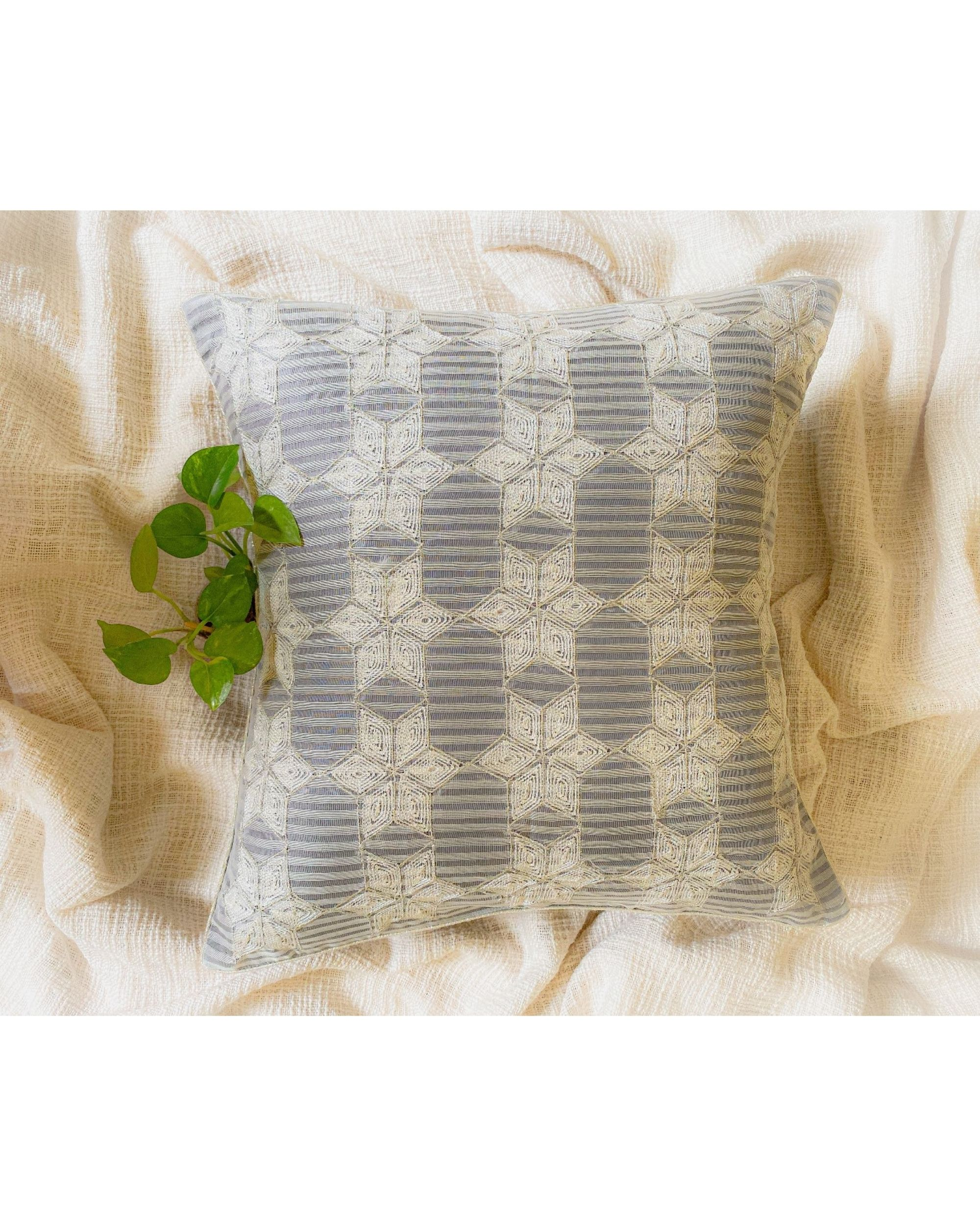 Light grey and white embroidered cushion cover