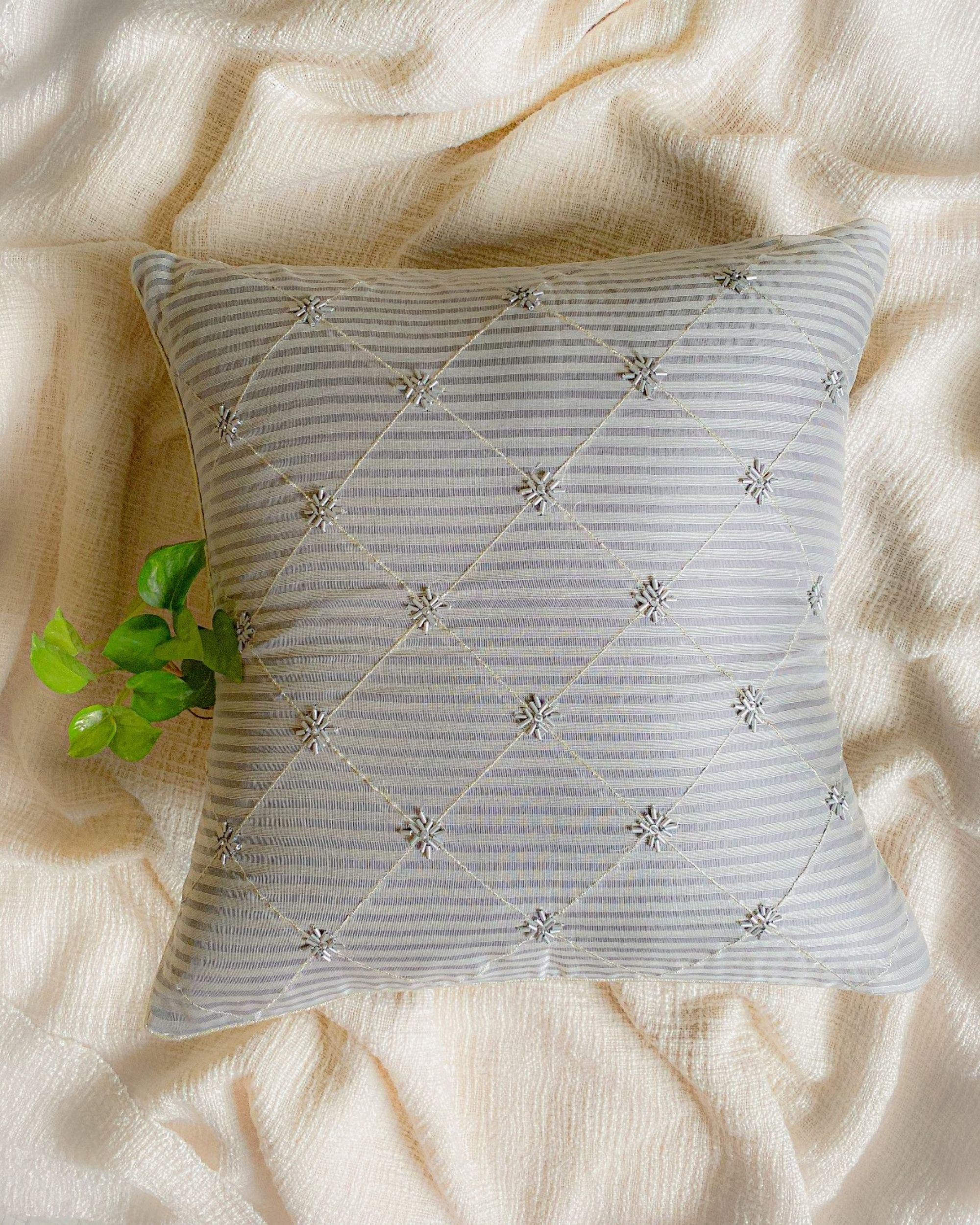 Light grey and white checkered cushion cover