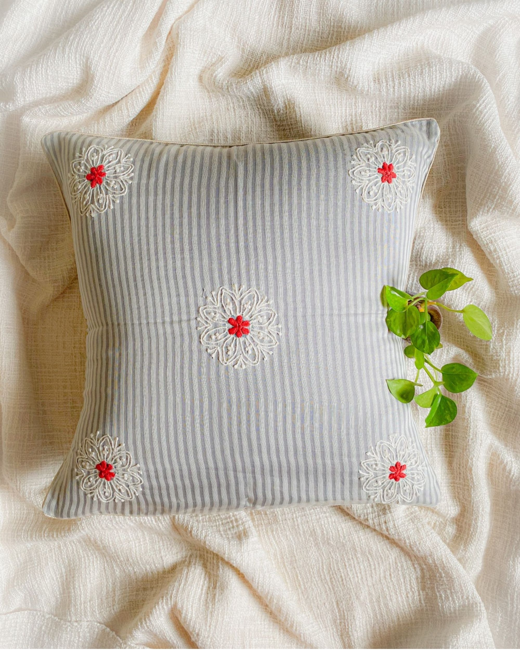 Light grey and white daisy embroidered cushion cover