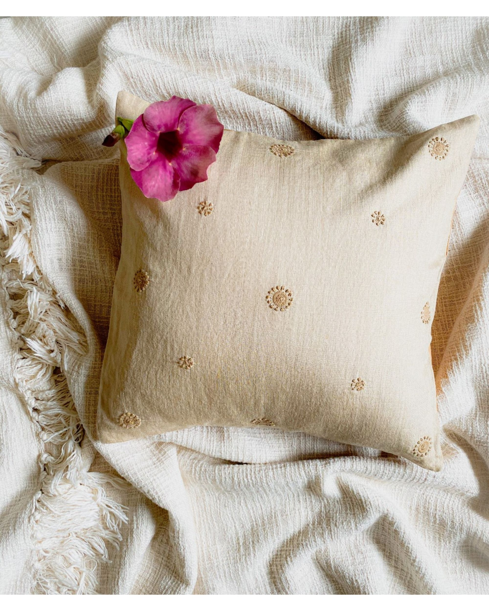 Beige marigold hand embroidered cushion cover