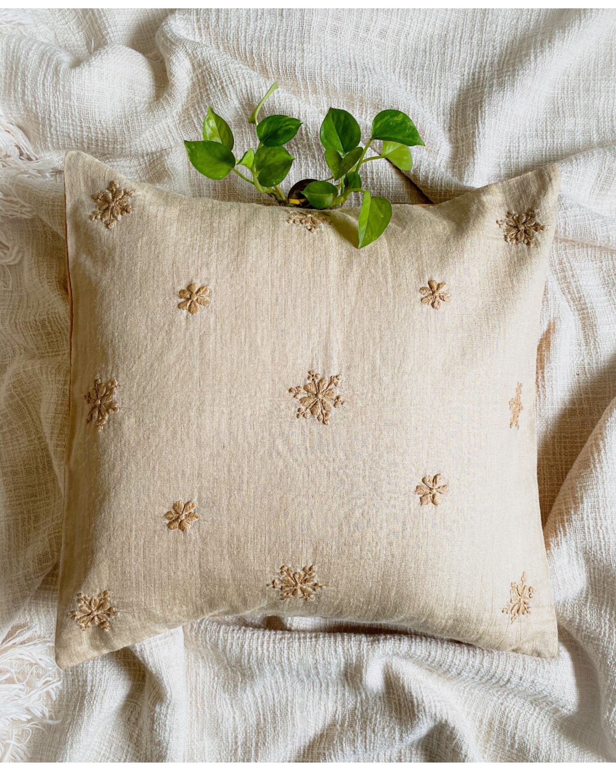 Beige snowflake hand embroidered cushion cover