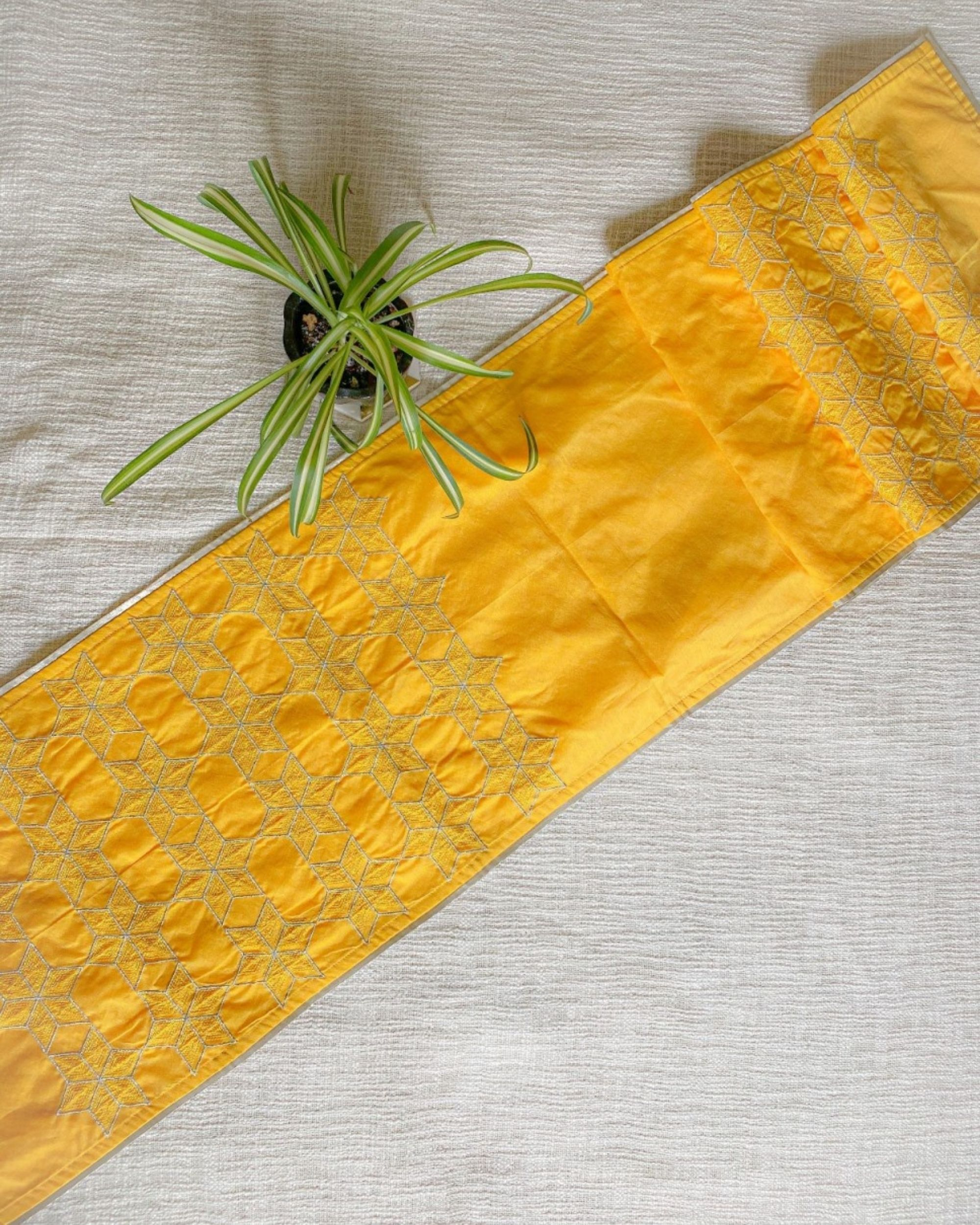 Yellow star embroidered table runner