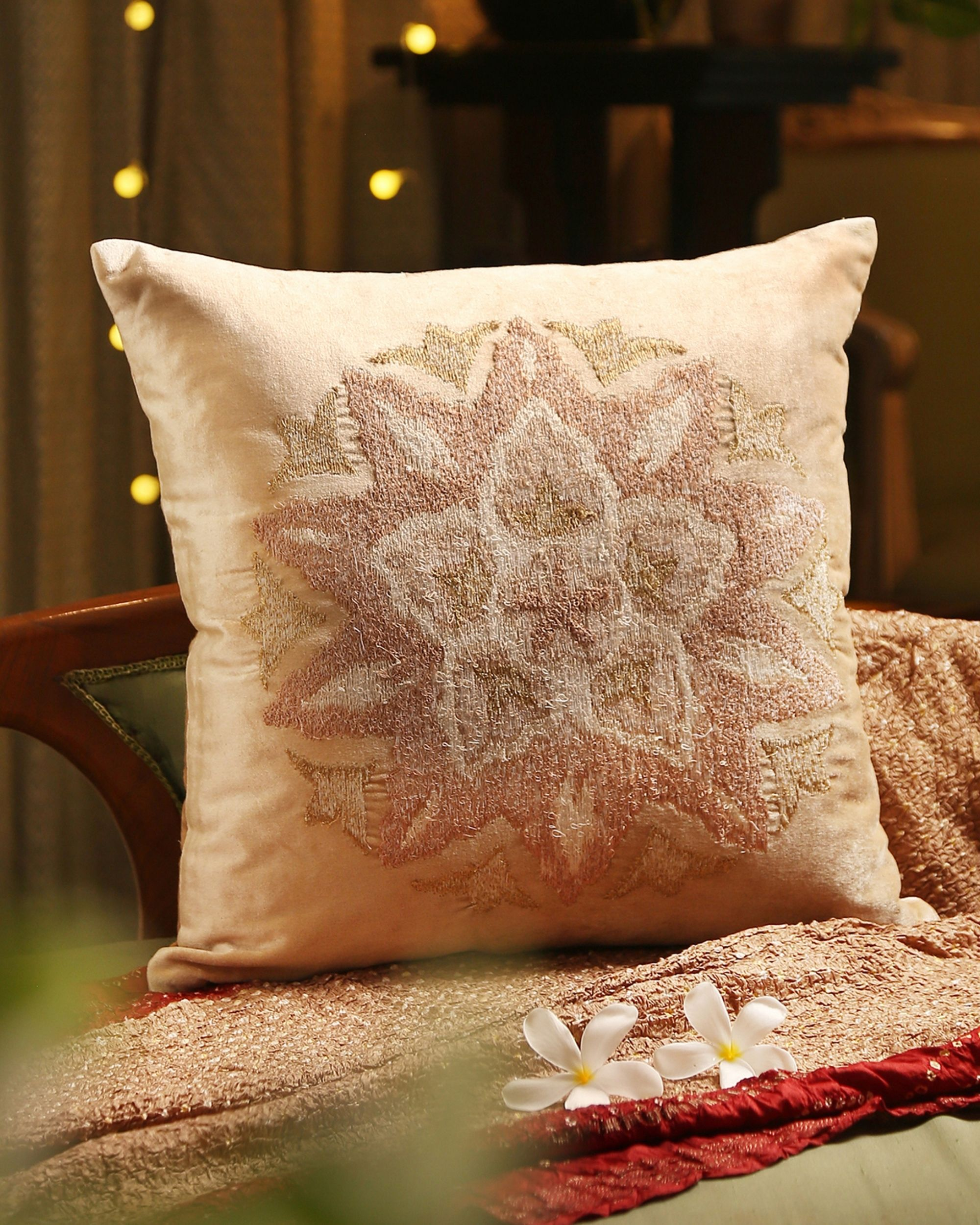 Beige floral motif embroidered cushion cover