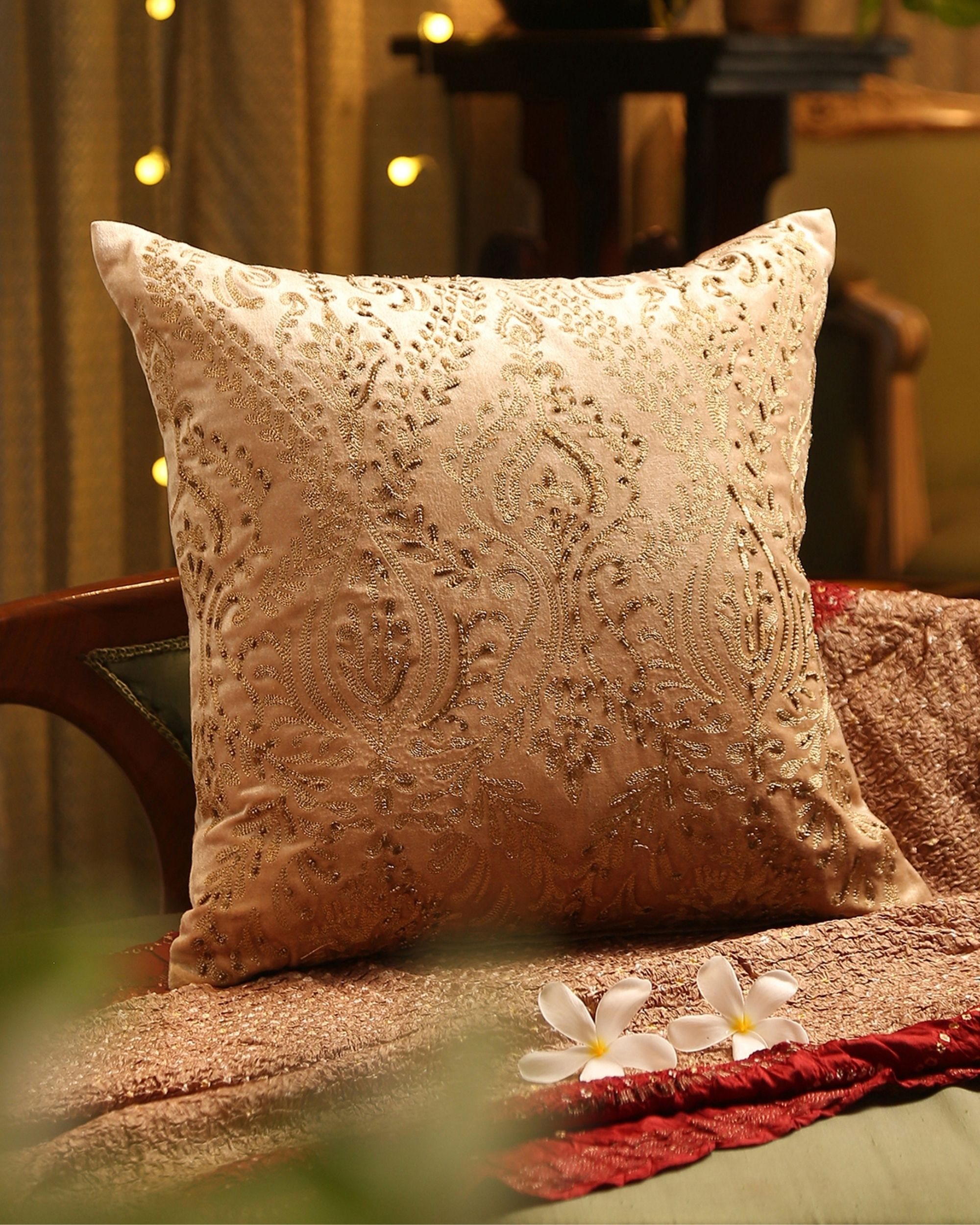 Beige zari embroidered cushion cover with hand bead work