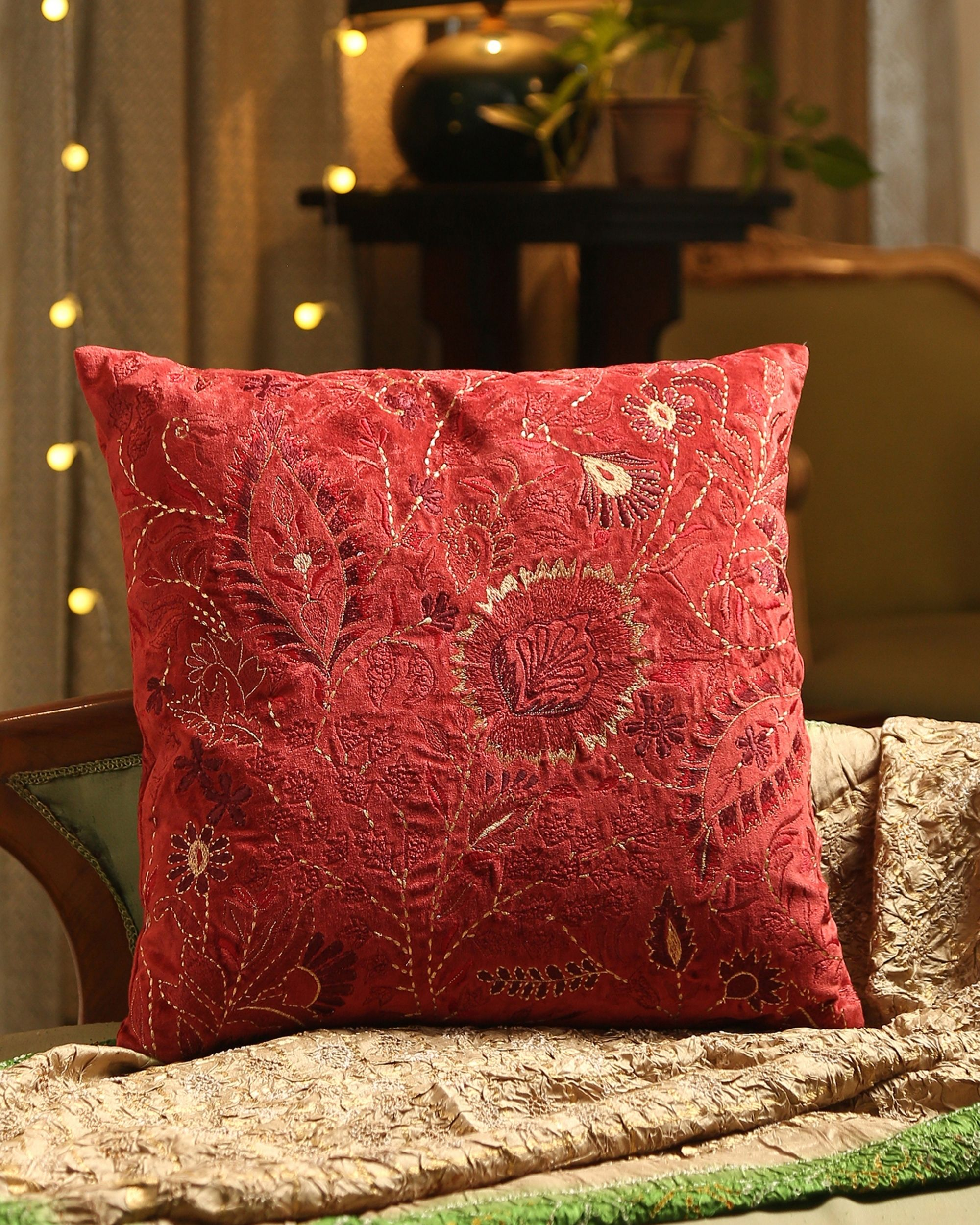 Burgundy floral motif embroidered cushion cover