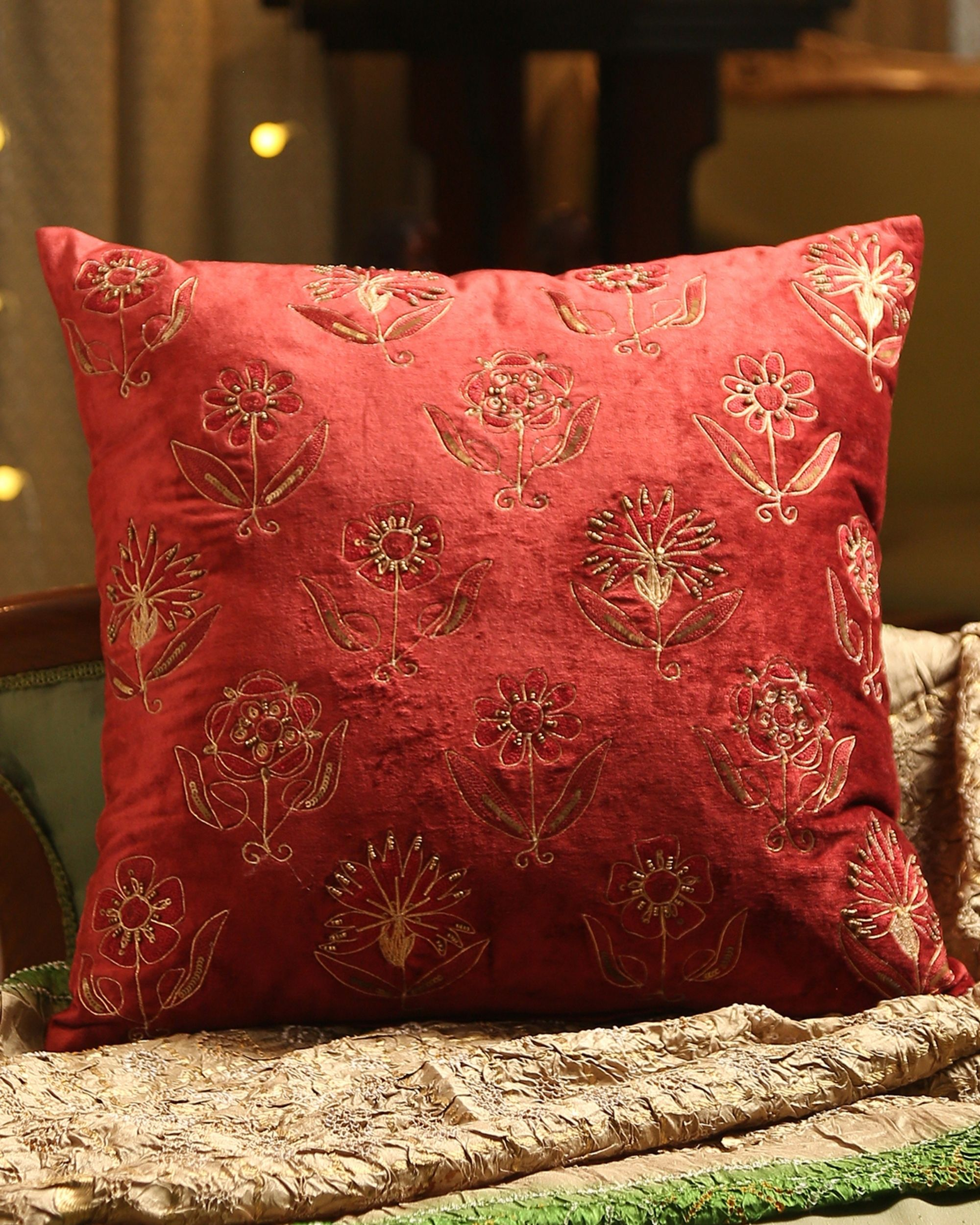 Burgundy floral motif hand beaded cushion cover