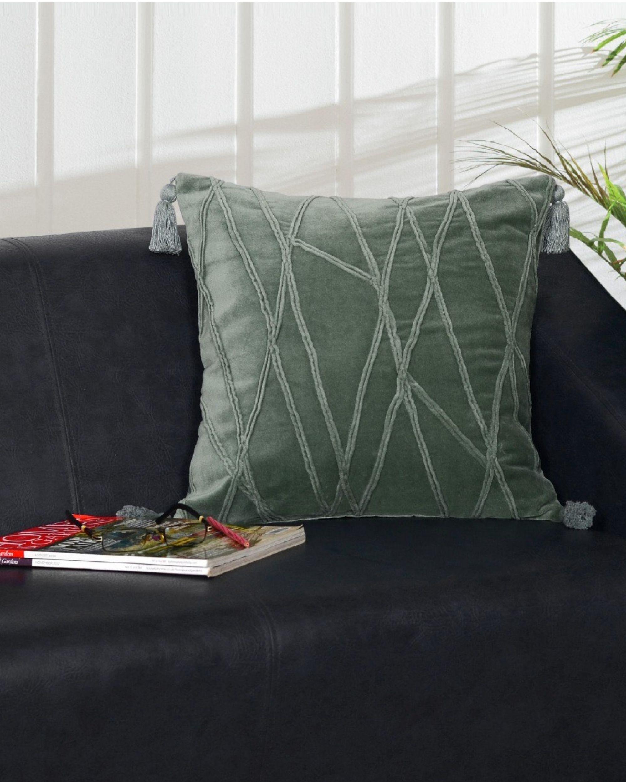 Green tasseled cushion cover