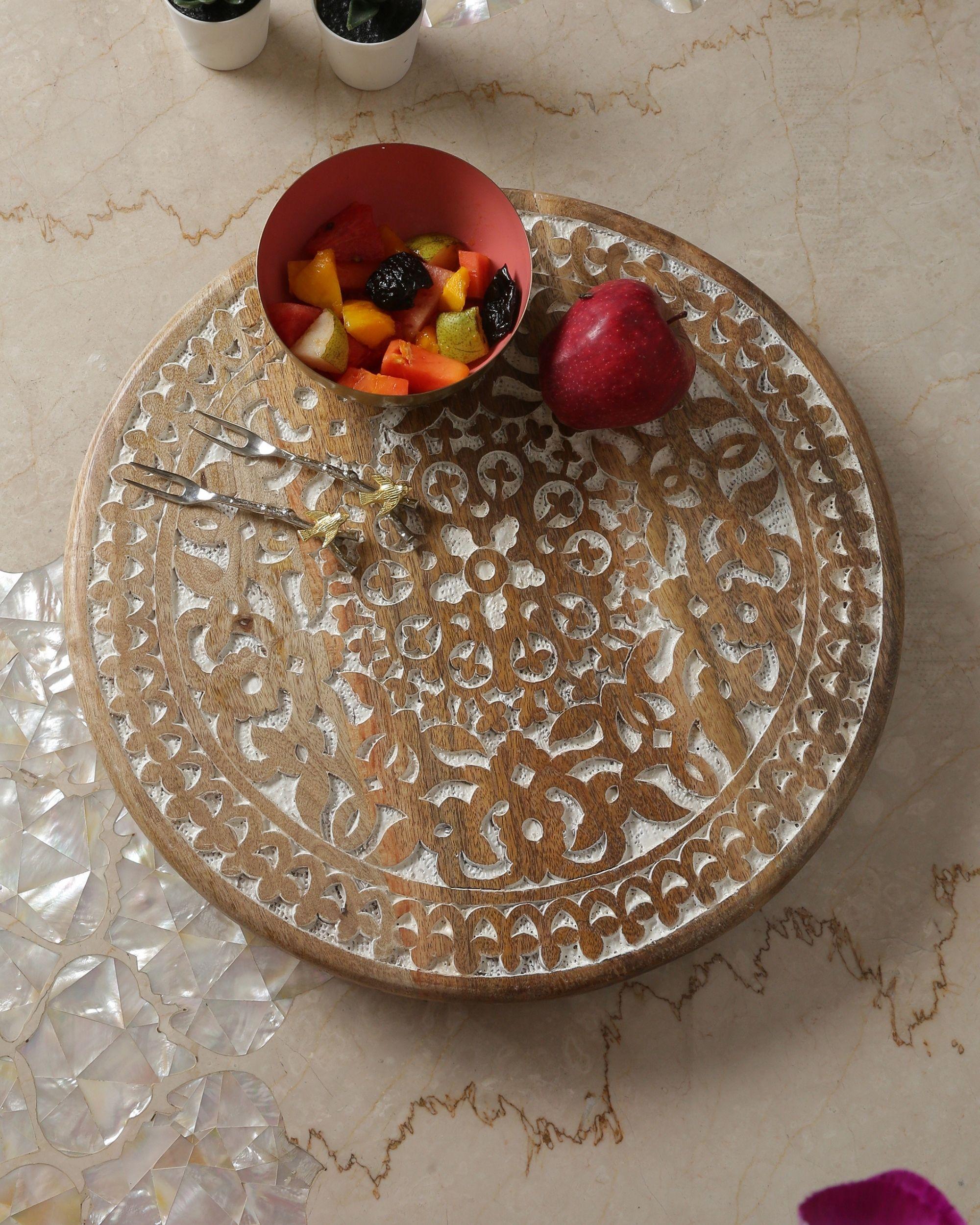 Floral hand carved rotating platter