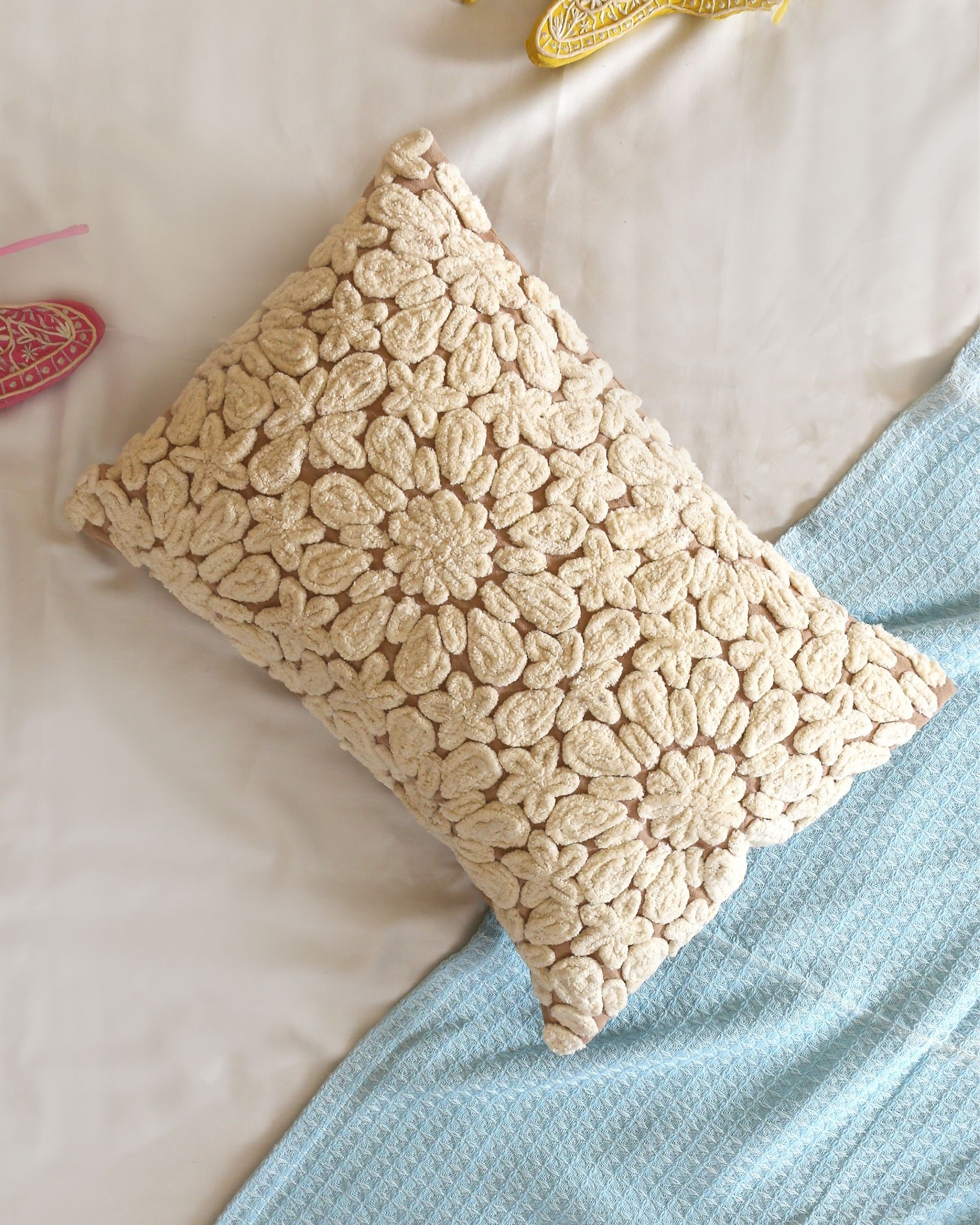 Cord embroidered cushion cover