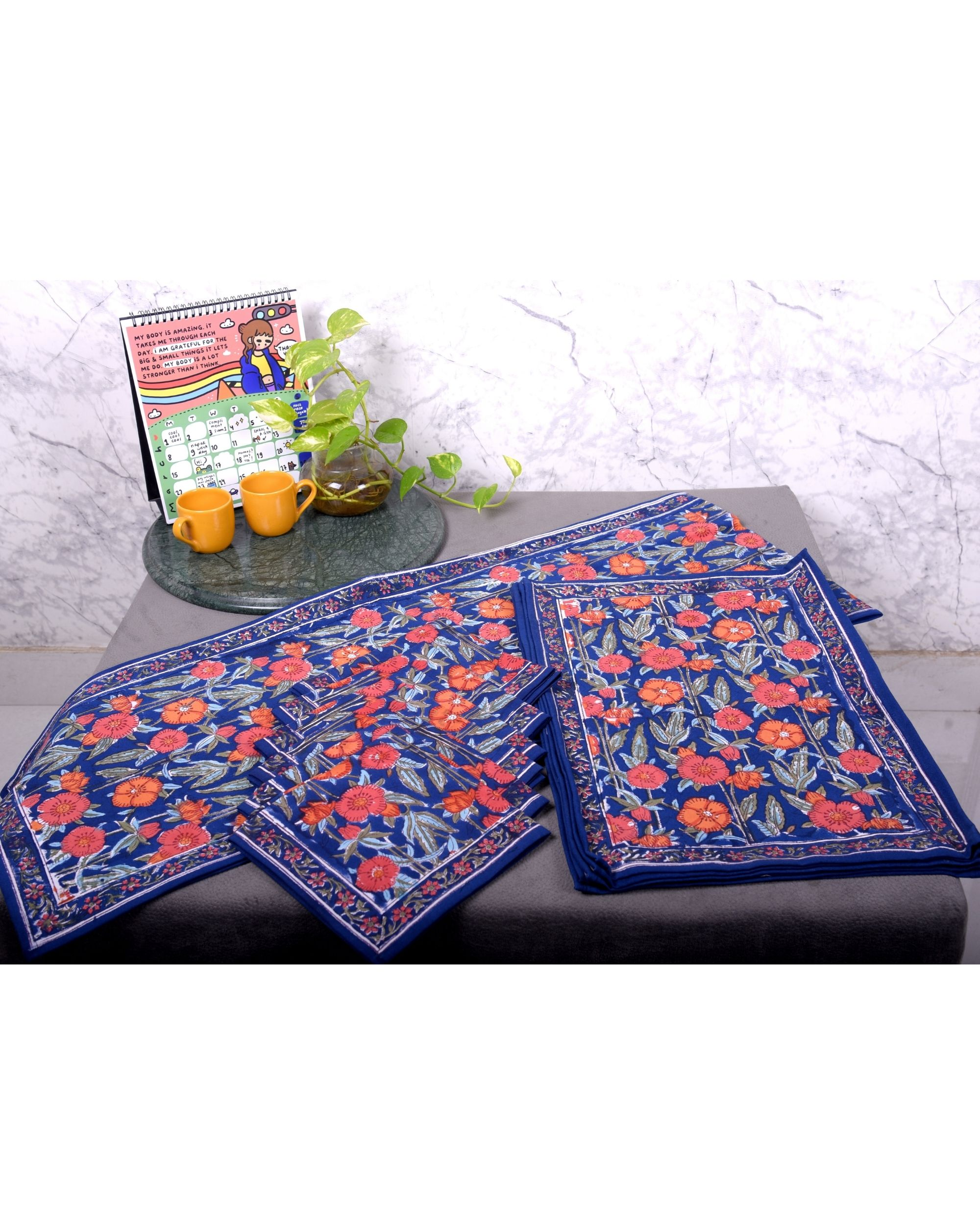 Blue and orange floral table runner, table mats and napkins - set of 13