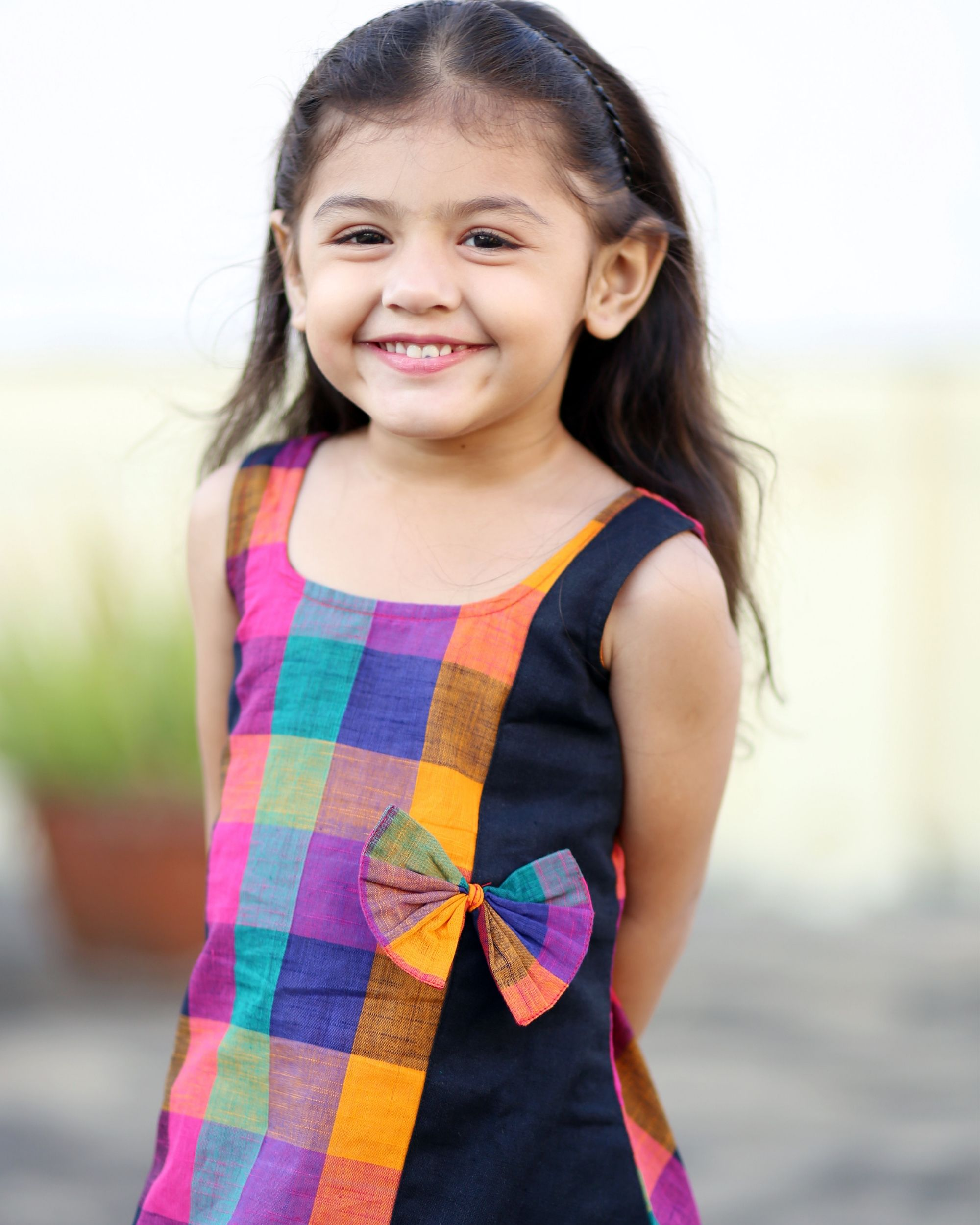 Multi colored checkered dress with bow