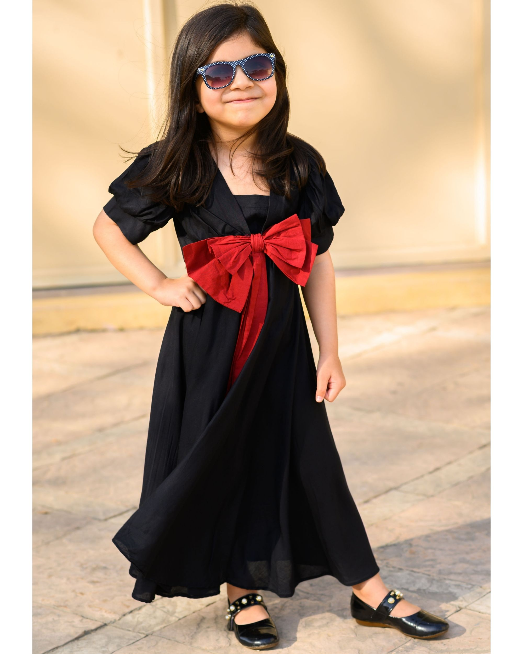 Black flared dress with red bow