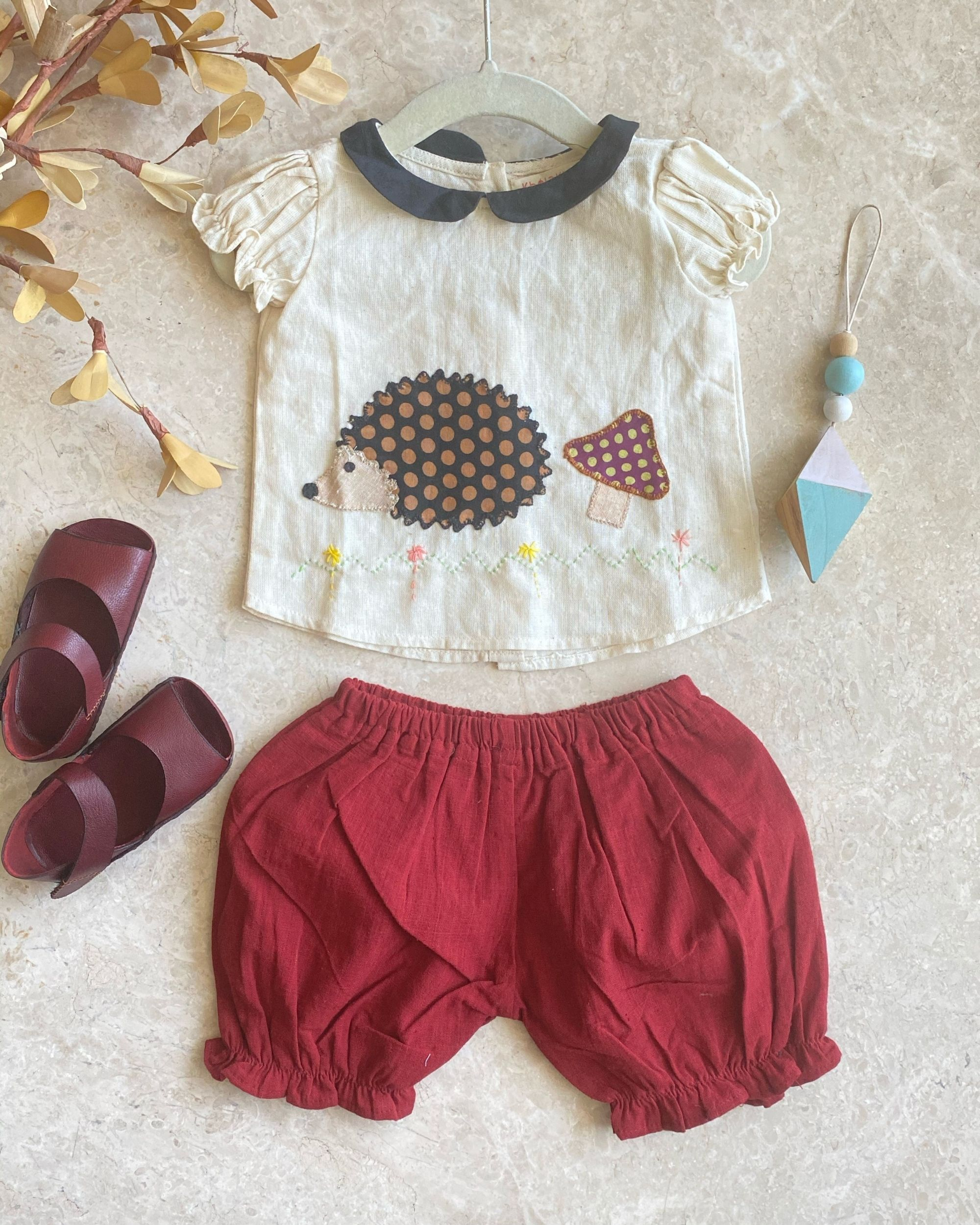 Off white hedgehog top with red knickers - set of two