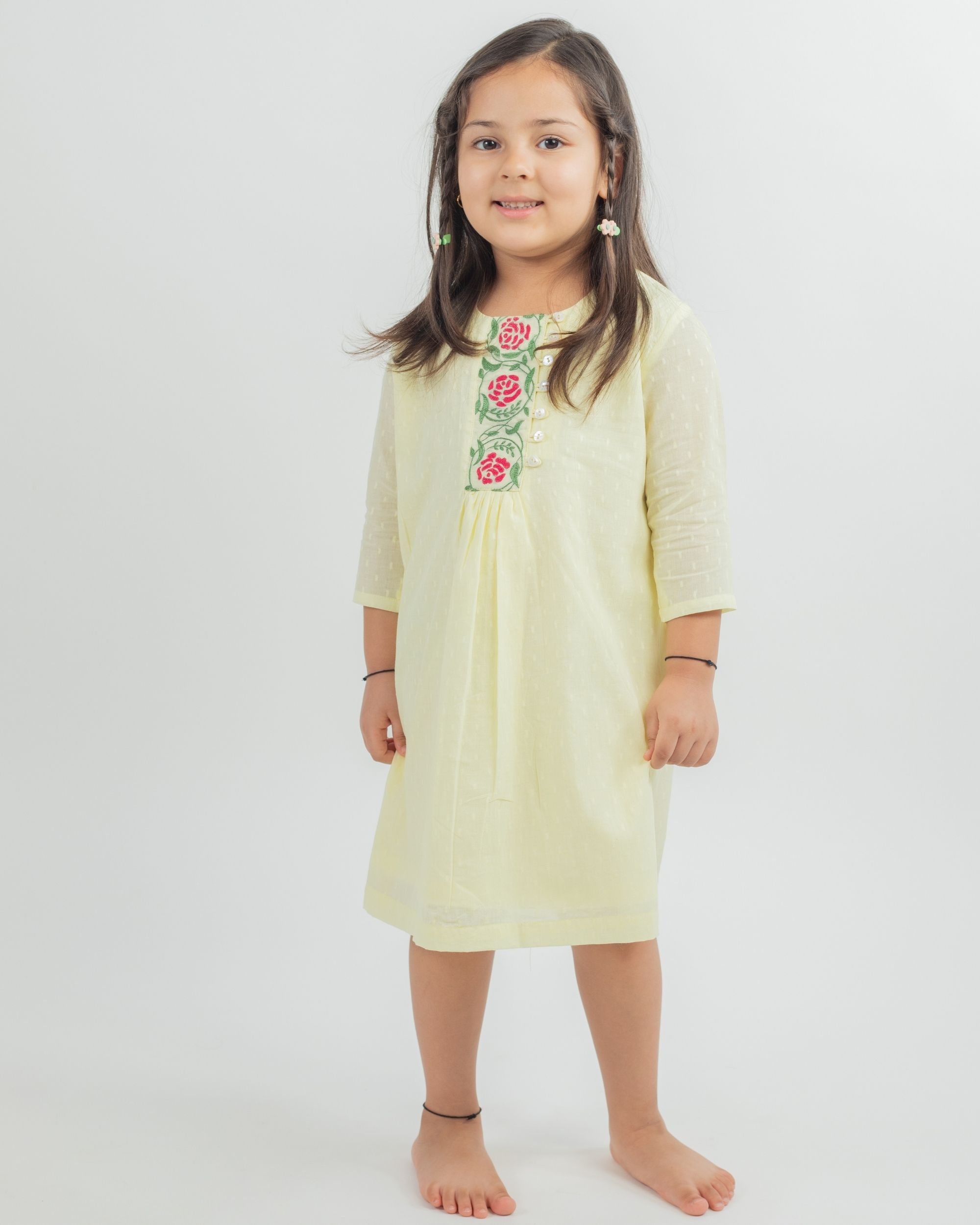 Pastel yellow hand embroidered floral yoke dress