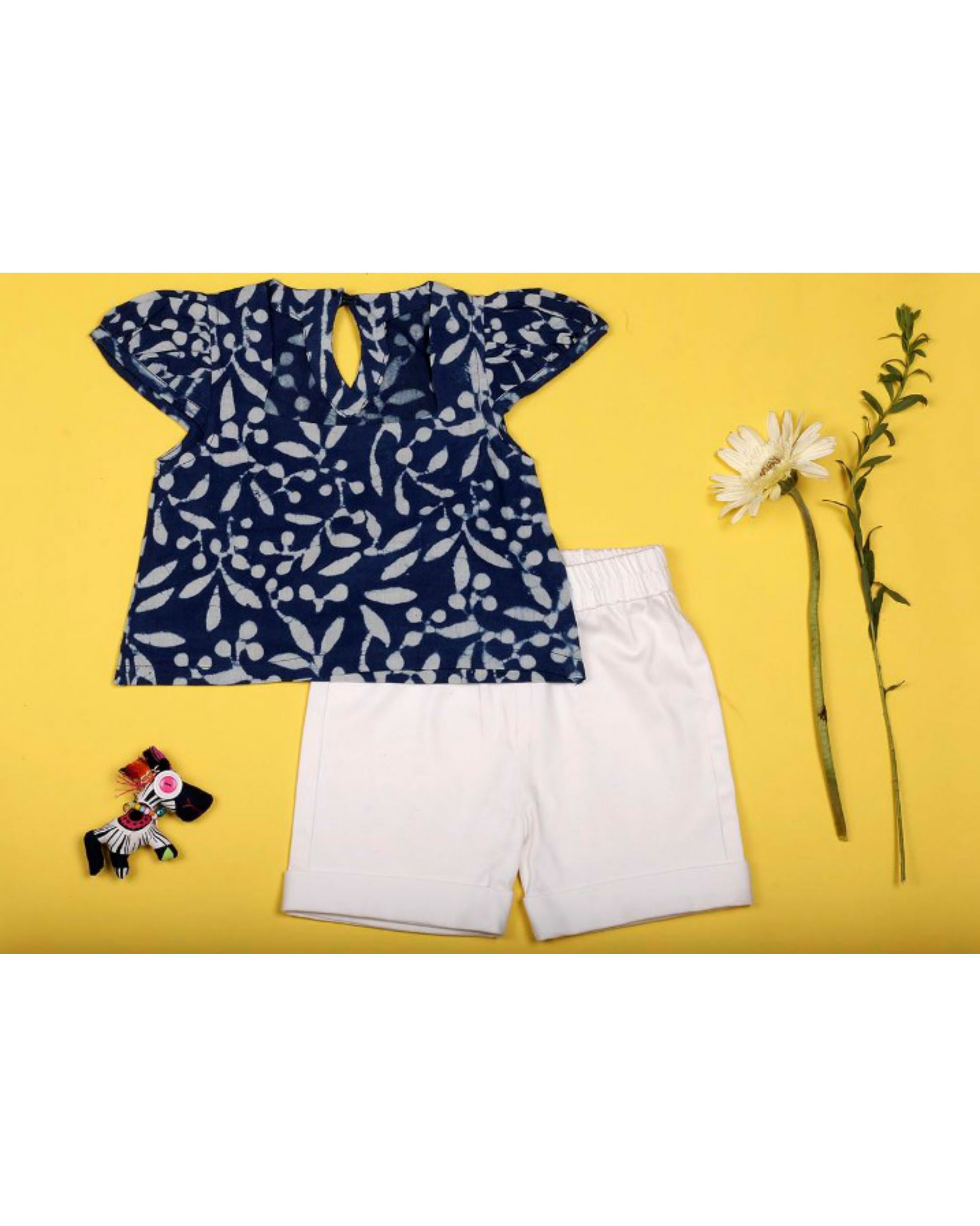 Indigo floral top with white shorts
