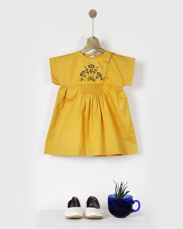 Embroidered yellow smocked dress