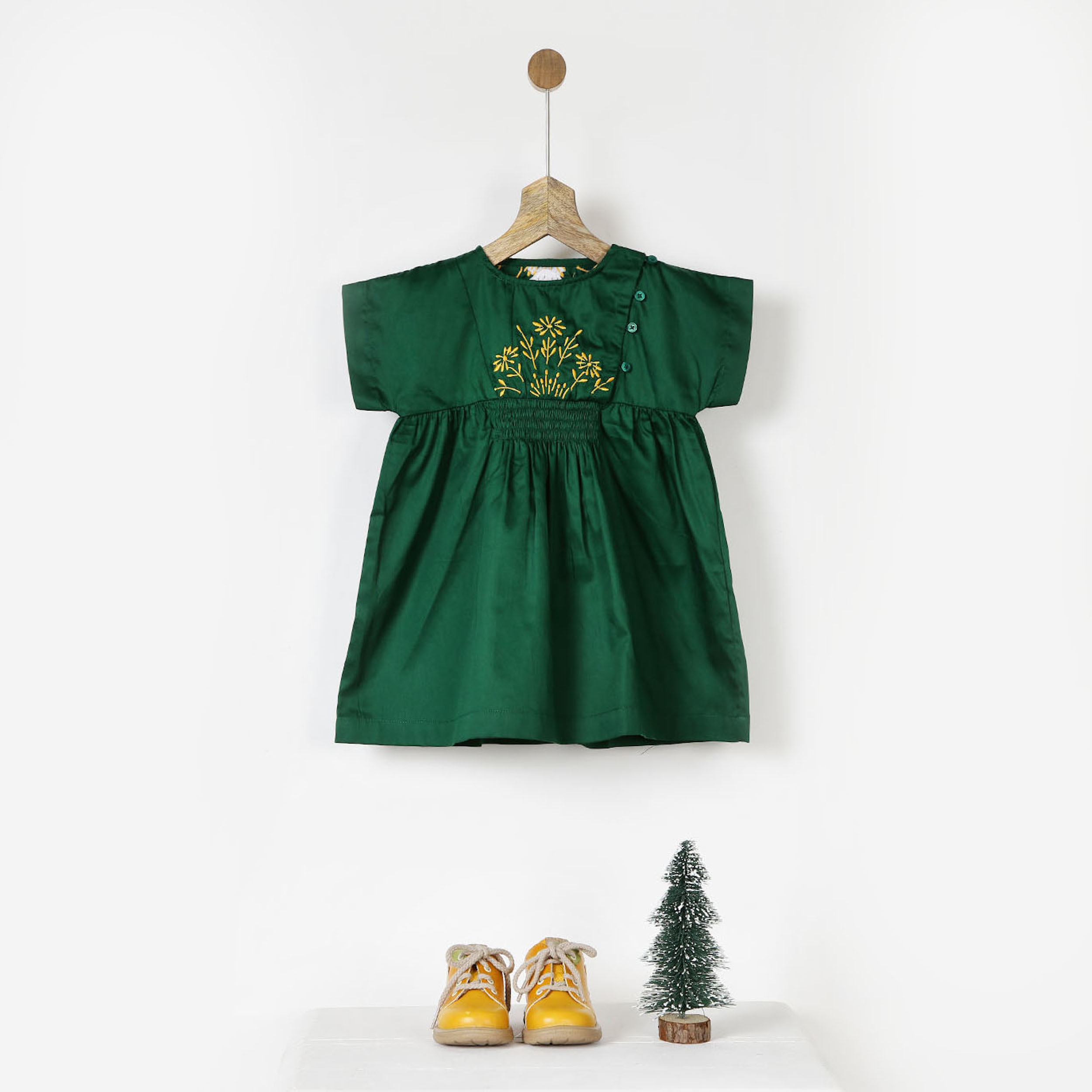 Embroidered green smocked dress