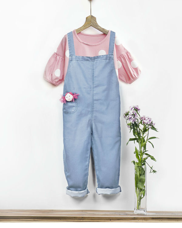 Ice wash denim romper with fabric brooch