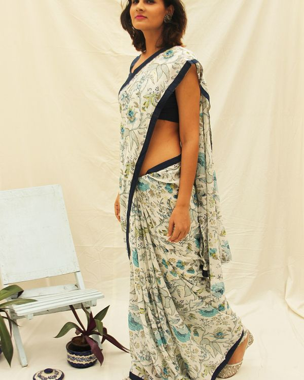 White printed cotton saree with all around black border detailing.  1