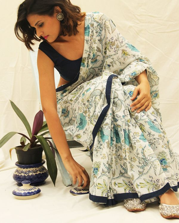 White printed cotton saree with all around black border detailing.  2