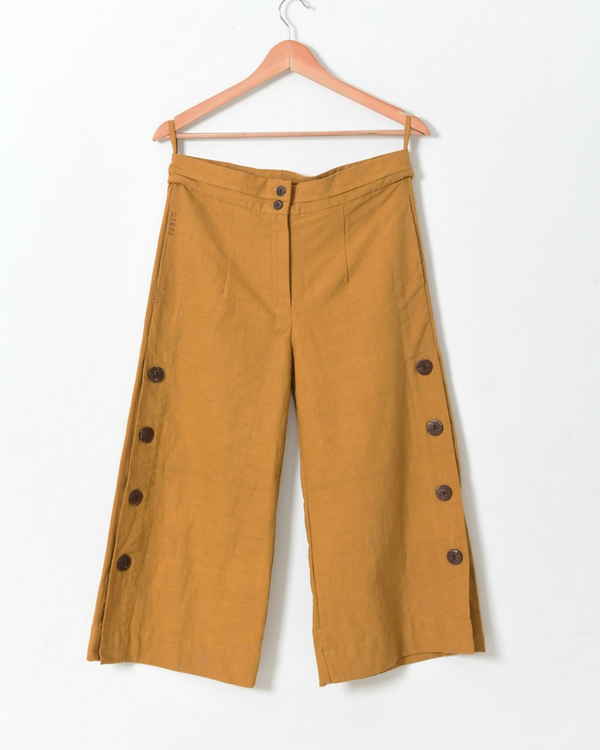 Pale mustard side open pants with buttons detailing 1
