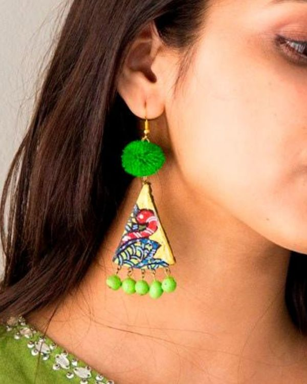 Peacock motif pom pom earring 1
