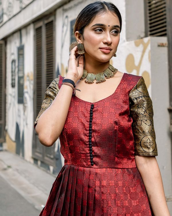 Red floral motif pleated dress with zari border detailing 1