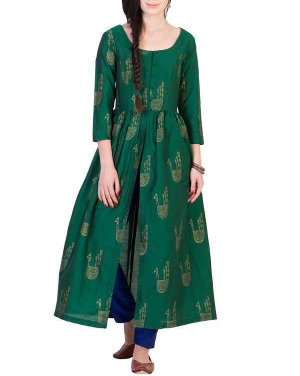 Green tunic with blue pleated pants 1