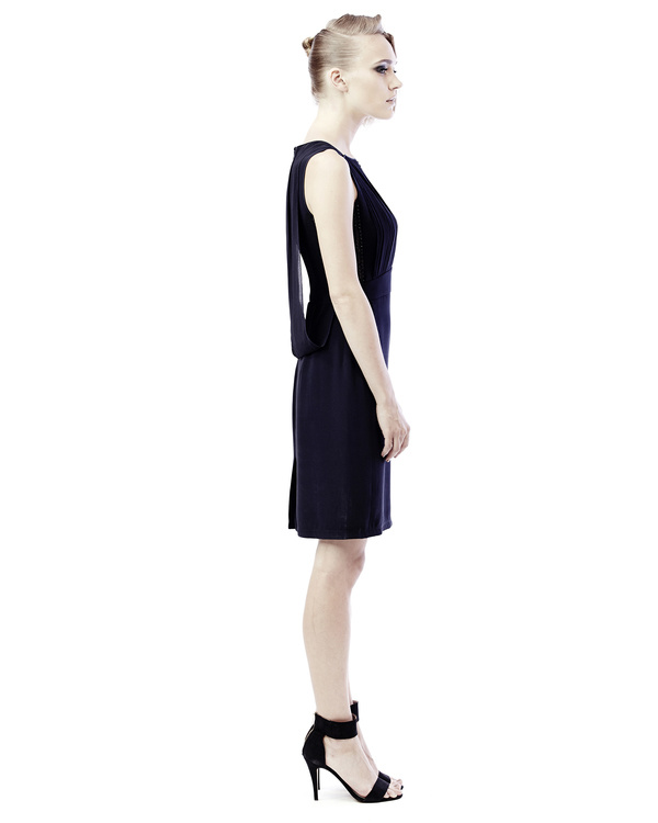 An evening dress with pleated yoke and leather details 3
