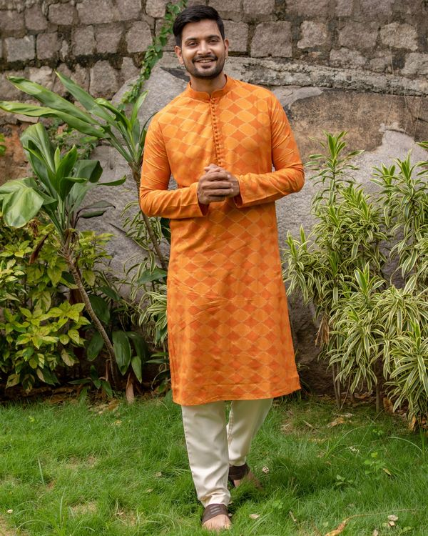 Orange and golden printed checkered kurta with off white pants - set of two 1