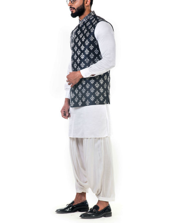 White linen satin kurta set with a black silk nehru jacket with white cord floral embroidery 2